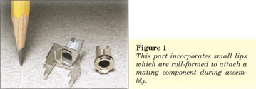 Figure 1 - Miniature Zinc Alloy Switch Assembly - This part incorporates small lips which are roll-formed to attach a mating component during assembly.